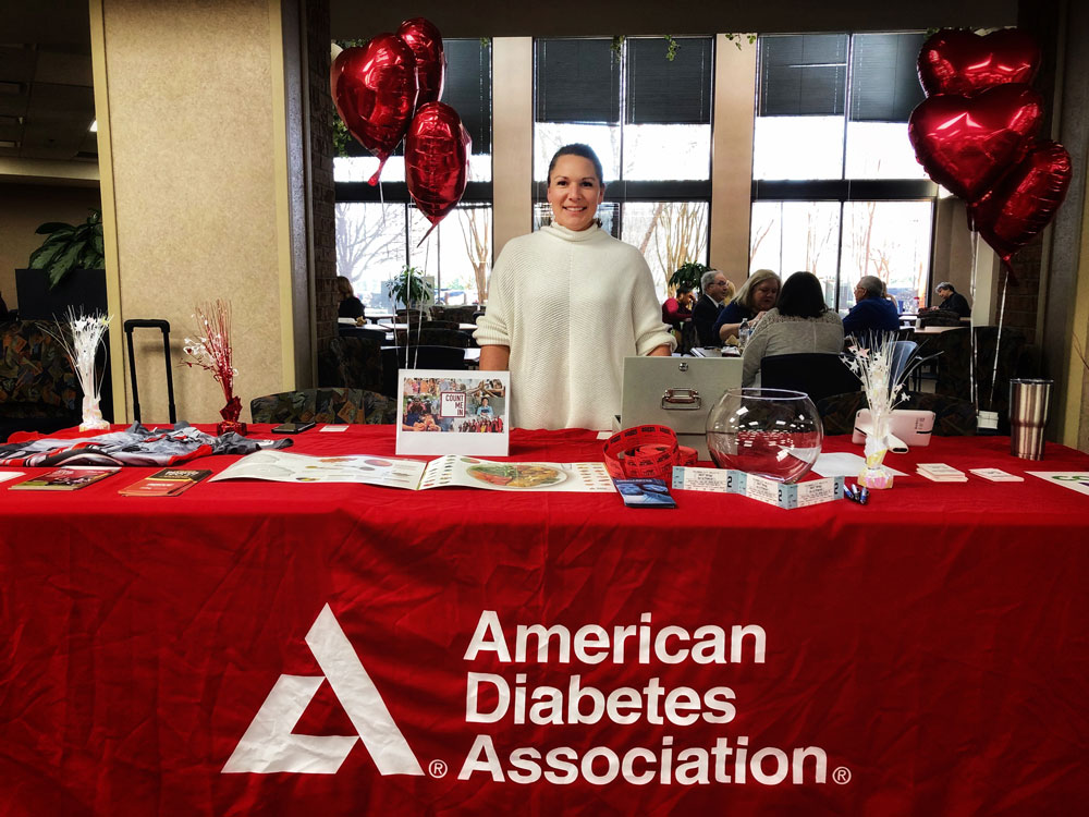 Tifani Moore at an American Diabetes Association table